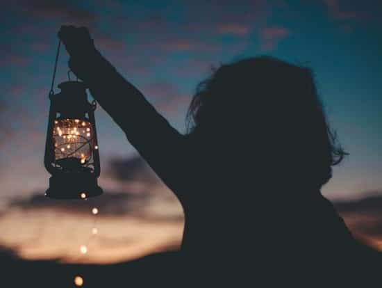 A young girl holding one of the best solar lanterns of the year
