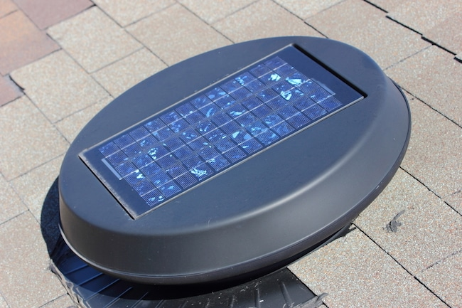 The best solar attic fan sitting on the pavement