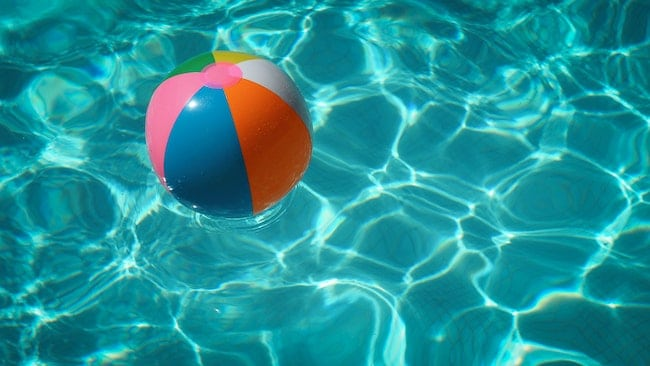 An inflatable ball inside a pool heated by the best solar pool heater