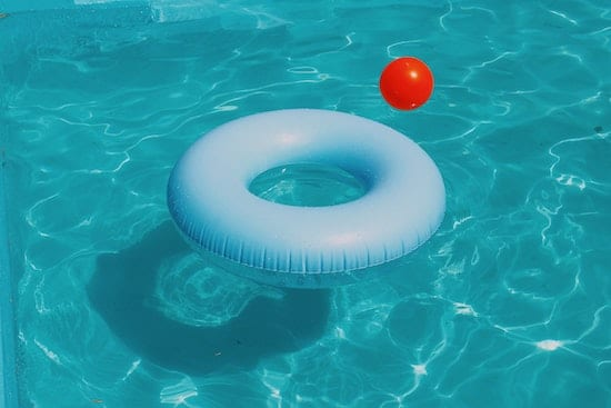 two inflatables in a pool heated by one of the top in-ground solar pool heaters of 2020
