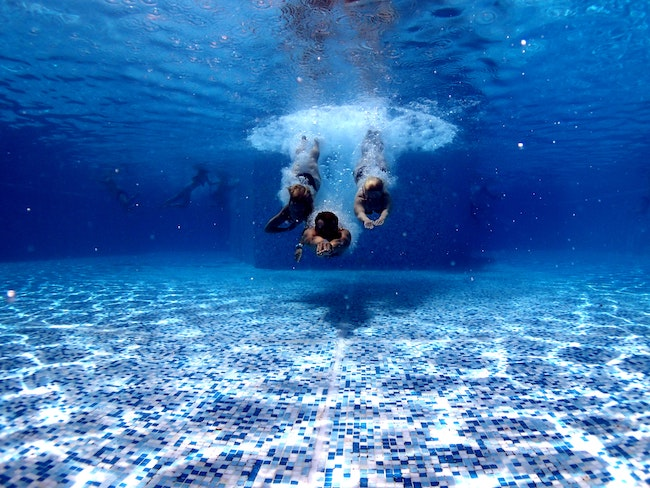 underwater photo of a pool heated by one of the best solar pool heaters of 2020