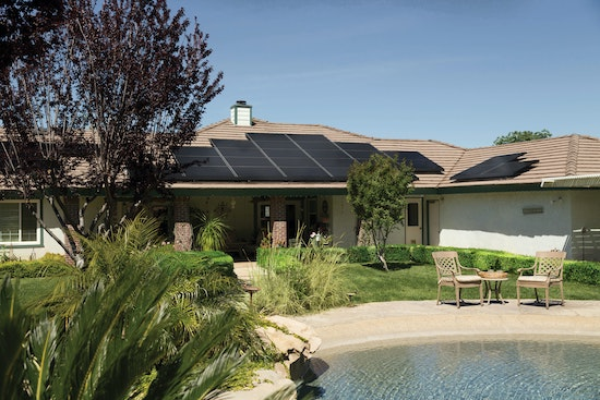 A backyard with solar panels charged by the best mppt charge controller of the year