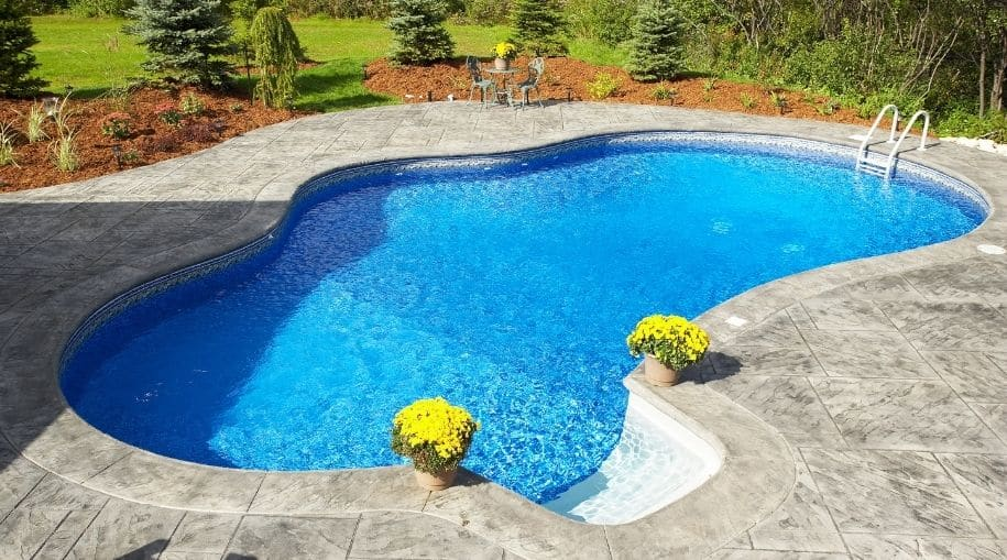 A backyard pool that could use a Clear Or Blue Solar Cover
