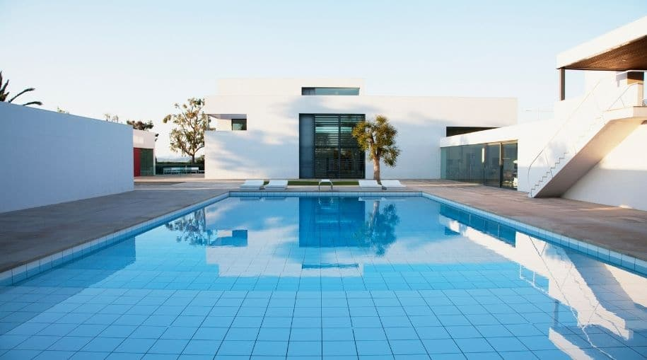 A beautiful, modern, pool using one of the Ways To Heat A Pool