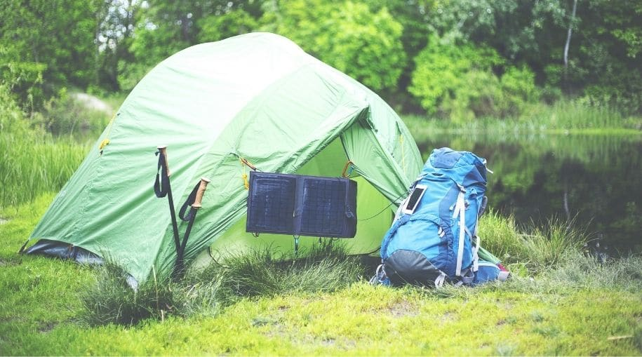 Green tent with a Waterproof Solar Backpack