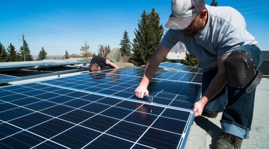 two men installing efficient solar panels